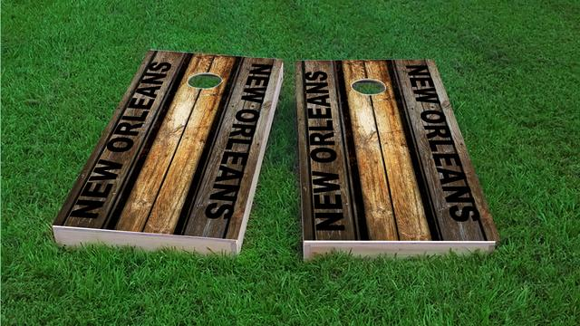 Woodslat Worn New Orleans Football Themed Custom Cornhole Board Design