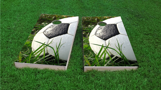 Soccer Ball in Grass Themed Custom Cornhole Board Design