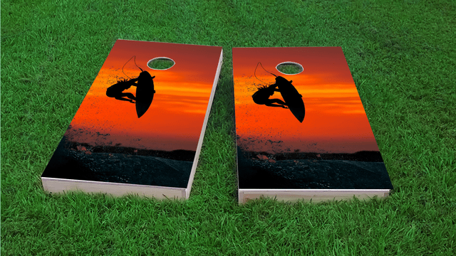 Surfer with Red Sky Themed Custom Cornhole Board Design