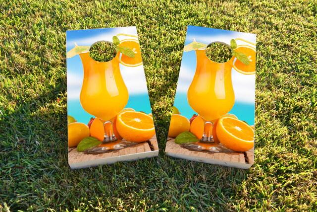 Orange Drink Themed Custom Cornhole Board Design