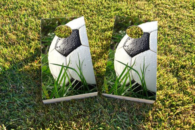 Soccer Ball in Grass Themed Custom Cornhole Board Design