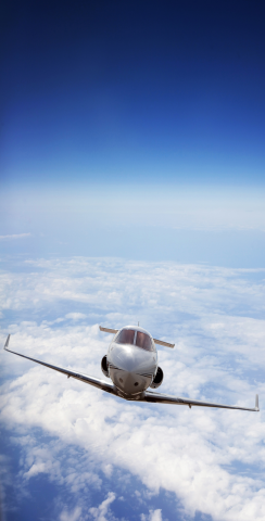 Private Jet Flying Above the Clouds