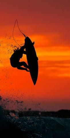Surfer with Red Sky Themed Custom Cornhole Board Design